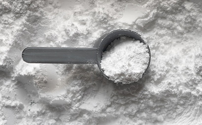 a scoop with protein powder