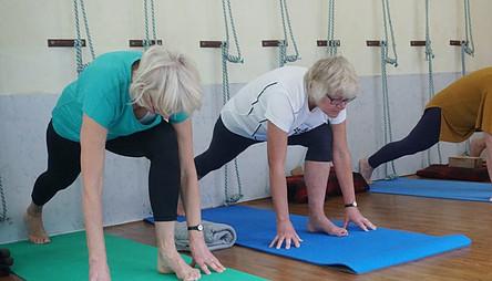 seniors women exercising on yoga mat